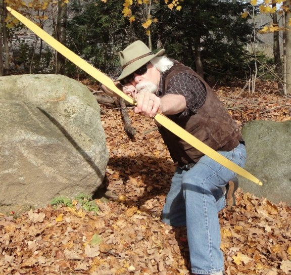 David Lohnes taking aim with his favorite stickbow hat (photo courtesy of David)