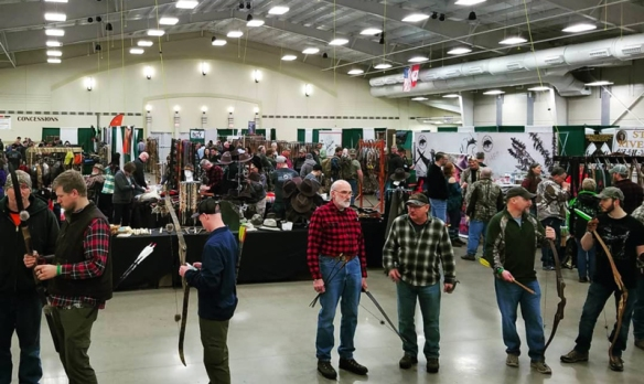Archers line up at the practice range at the 2018 Traditional Bowhunter's Expo.