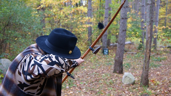 Steve Angell lines up for a shot with his longbow at hunting camp.