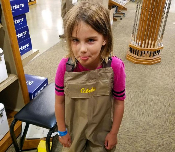My daughter Aubrey in her first pair of waders.